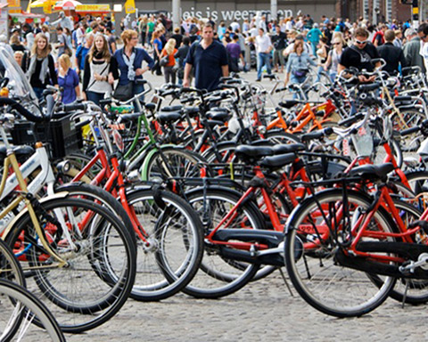 a large number of bicycles parked in a courtyard