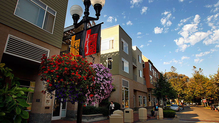 buildings and hanging flower baskets in Downtown Eugene