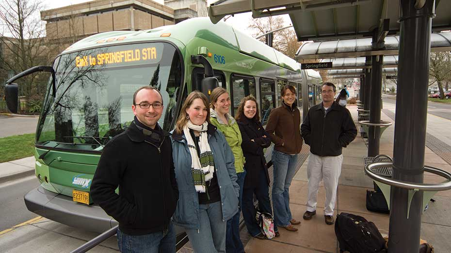 Students in front of the EmX bus