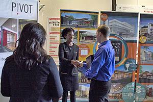 students speak with job recruiter