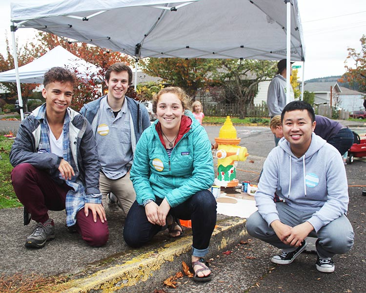 Andrei Eugenio, Gillian Garber-Yonts, Emily Fagan, and Brian Soutavong with fire hydrant they helped paint