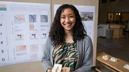 Ali Lau, an architecture graduate student, holds a model of her project. (Phillip Quinn/Emerald)