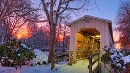 Photo of a Cottage Grove covered bridge in the snow