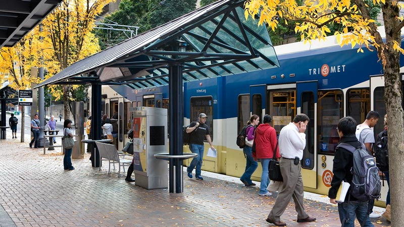 Riders board a MAX light rail train in Portland. Photo courtesy of TriMet.