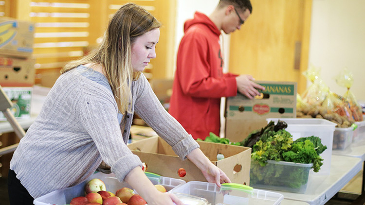student prepares fruits and vegetables